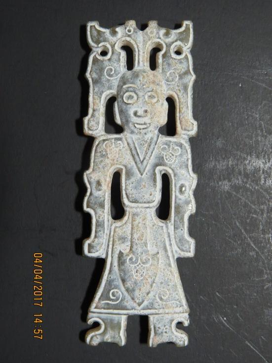 Amorphous silicate on a Zhou jade man
