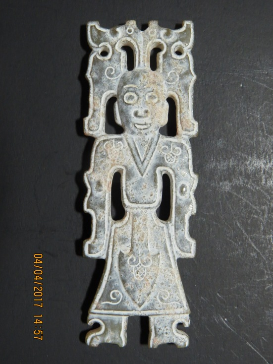 Amorphous silicate on a Zhou jade man