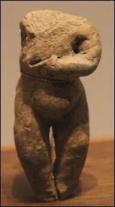 Pregnant woman clay figerine.